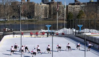 The Calgary Flames practice on a rink in New York's Central Park Saturday, Feb. 4, 2017.  The Flames are set to play the New York Rangers on Sunday.  (AP Photo/Craig Ruttle)