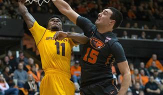 Arizona State's Andre Adams (11) has his shot contested by Oregon State's Tanner Sanders (15) during the second half of an NCAA college basketball game in Corvallis, Ore., Saturday, Feb. 4, 2017. Arizona State won 81-68. (AP Photo/Timothy J. Gonzalez)