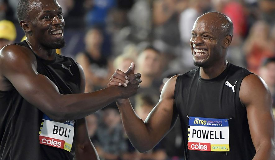 Jamaica's Usain Bolt, left, and teammate Asafa Powell celebrate after winning the mixed 4 x 100 meter relay at the Nitro Athletics meet in Melbourne, Australia, Saturday, Feb. 4, 2017. (AP Photo/Andy Brownbill)