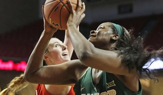 Baylor's Kalani Brown (21) shoots the ball over Texas Tech's Brittany Brewer (20) during an NCAA basketball game Saturday, Feb. 4, 2017, in Lubbock, Texas. (AP Photo/Brad Tollefson)