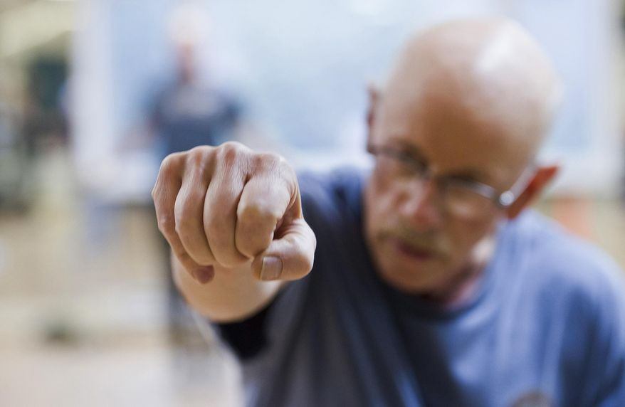 ADVANCE FOR WEEKEND FEB. 4-5, 2017 AND THEREAFTER - In this photo taken Jan. 26, 2017, Tim Smith shadow boxes during the Rock Steady Boxing class at Pavitt Health & Fitness in Juneau, Alaska. The class is offered to those with various stages of Parkinson's disease. (Michael Penn/Juneau Empire via AP)