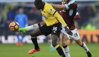 Burnley's George Boyd, right, and Watford's Abdoulaye Doucoure battle for the ball during the English Premier League soccer match at Vicarage Road, Watford, England, Saturday Feb. 4, 2017. (Nigel French/PA via AP)