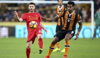 Liverpool's Adam Lallana (left) and Hull City's Tom Huddlestone battle for the ball during the English Premier League soccer match at the KCOM Stadium, Hull, England, Saturday Feb. 4, 2017. (Danny Lawson/PA via AP)