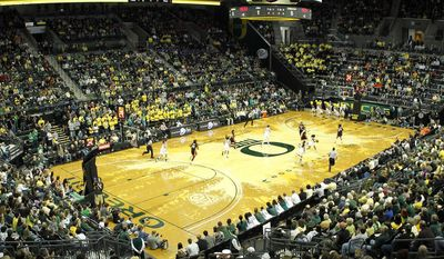 In this undated photo provided by the University of Oregon, Oregon takes on Oregon State in an NCAA college basketball game in Eugene, Ore.College basketball floors once had simple designs, the only flair usually the addition of color in the lane or at midcourt. Court designs have taken a creative twist over the past few years with schools adding elaborate detail. (Eric Evans/University of Oregon via AP)