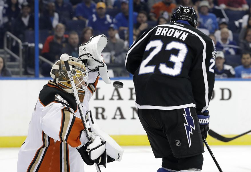 Anaheim Ducks goalie Jonathan Bernier (1) makes the save on a deflection by Tampa Bay Lightning right wing J.T. Brown (23) during the second period of an NHL hockey game Saturday, Feb. 4, 2017, in Tampa, Fla. (AP Photo/Chris O'Meara)