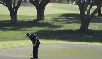 Nacho Elvira of Spain plays a shot on the 7th hole during the 2nd round completion of the Dubai Desert Classic golf tournament in Dubai, United Arab Emirates, Saturday, Feb. 4, 2017. (AP Photo/Kamran Jebreili)