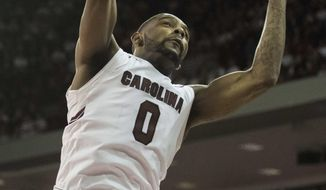 South Carolina guard Sindarius Thornwell (0), with teammate Duane Notice (10), grabs a rebound during the first half of an NCAA college basketball game against Georgia Saturday, Feb. 4, 2017, in Columbia, S.C. (AP Photo/Sean Rayford)