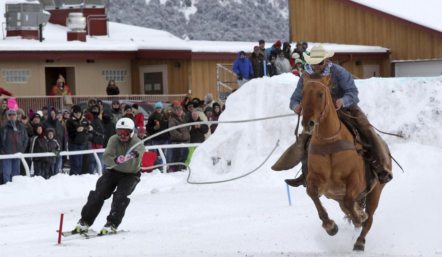 FOR RELEASE SATURDAY, FEBRUARY 4, 2017, AT 12:01 A.M. MST.- In this photo taken Jan. 7, 2017, a cowboy and skier compete at the San Juan Skijoring event, in Ridgway, Colo. In this fascinating and unique winter sport, horse and rider pull a skier over jumps and through slalom gates.(Dale Shrull /The Grand Junction Daily Sentinel via AP)