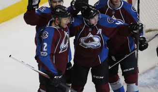 From front left, Colorado Avalanche right wing Jarome Iginla celebrates scoring a goal with left wing Matt Nieto, and centers Matt Duchene and Mikhail Grigorenko, of Russia, against the Winnipeg Jets in the first period of an NHL hockey game Saturday, Feb. 4, 2017, in Denver. (AP Photo/David Zalubowski)