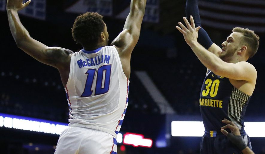 Marquette guard Andrew Rowsey, right, shoots over DePaul forward Tre' Darius McCallum during the first half of an NCAA college basketball game Saturday, Feb. 4, 2017, in Rosemont, Ill. (AP Photo/Nam Y. Huh)