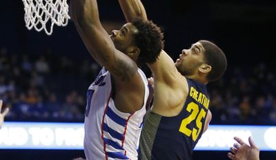 DePaul forward Tre' Darius McCallum, left, battles for a rebound against Marquette guard Haanif Cheatham during the first half of an NCAA college basketball game Saturday, Feb. 4, 2017, in Rosemont, Ill.(AP Photo/Nam Y. Huh)