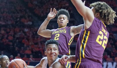 Illinois' guard Te'Jon Lucas (3) is guarded by Minnesota's Nate Mason (2) and Reggie Lynch (22) during an NCAA college basketball game in Champaign, Ill., on Saturday, Feb. 4, 2017.(AP Photo/Robin Scholz)