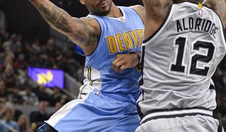 Denver Nuggets guard Jameer Nelson, left, looks to pass around San Antonio Spurs forward LaMarcus Aldridge during the first half of an NBA basketball game, Saturday, Feb. 4, 2017, in San Antonio. (AP Photo/Darren Abate)