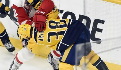 Detroit Red Wings defenseman Jonathan Ericsson (52), of Sweden, and Nashville Predators left wing Viktor Arvidsson (38), also of Sweden, fight for the puck during the first period of an NHL hockey game Saturday, Feb. 4, 2017, in Nashville, Tenn. (AP Photo/Mark Zaleski)