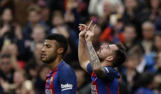 FC Barcelona's Paco Alcacer, right, celebrates scoring during the Spanish La Liga soccer match between FC Barcelona and Athletic Bilbao at the Camp Nou in Barcelona, Spain, Saturday, Feb. 4, 2017. (AP Photo/Manu Fernandez)