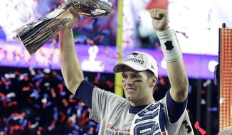 ADVANCE FOR WEEKEND EDITIONS, FEB 4-5 - FILE - In this Feb. 1, 2015, file photo, New England Patriots quarterback Tom Brady celebrates with the Vince Lombardi Trophy after they defeated the Seattle Seahawks 28-24 in the NFL Super Bowl XLIX football in Glendale, Ariz. There's no hiding it. One edge the New England Patriots have over the Atlanta Falcons in Sunday's Super Bowl can't be denied: experience. (AP Photo/Michael Conroy, File)