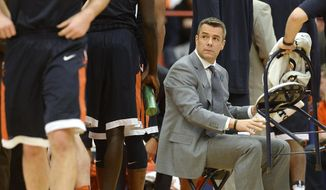 Virginia head coach Tony Bennett after a team timeout during the first half of an NCAA college basketball game in Syracuse, N.Y., Saturday, Feb. 4, 2017. (AP Photo/Adrian Kraus)