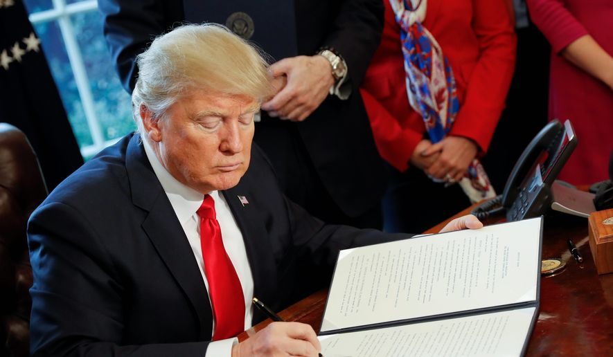 President Donald Trump signs an executive order in the Oval Office of the White House in Washington, Friday, Feb. 3, 2017. Trump signed an executive order that will direct the Treasury secretary to review the 2010 Dodd-Frank financial oversight law, which reshaped financial regulation after 2008-2009 crisis. (AP Photo/Pablo Martinez Monsivais) ** FILE **
