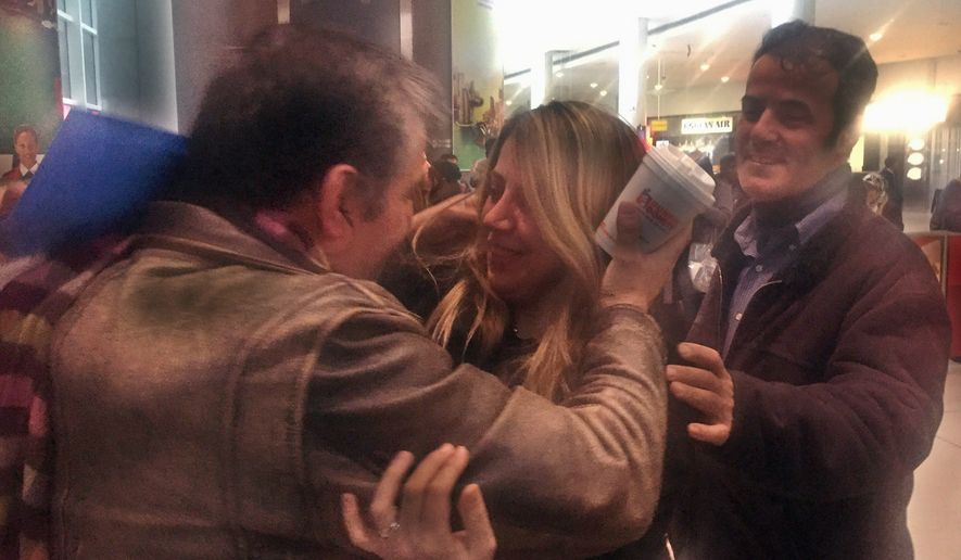 Fariba Tajrostami of Iran embraced family members at New York's John F. Kennedy International Airport on Sunday, a week after she was turned away and sent back to Tehran. (Associated Press)
