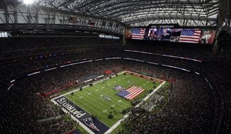 The American Flag is displayed on the field as Luke Bryan sings the national anthem before the NFL Super Bowl 51 football game between the Atlanta Falcons and the New England Patriots Sunday, Feb. 5, 2017, in Houston. (AP Photo/Morry Gash)