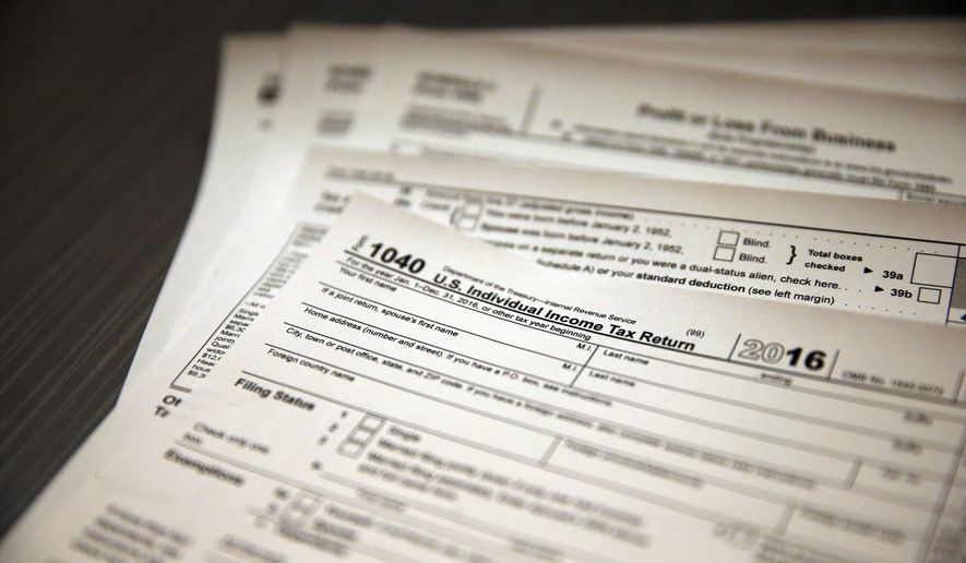 A Maryland bill, approved by the state Senate on a 28-17 vote, would require presidential and vice presidential candidates to release the preceding five years of their tax returns to appear on the ballot.  (AP Photo/Brennan Linsley)