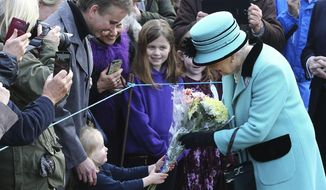 Britain's Queen Elizabeth II stops to receive flowers from 3-year old Jessica Atfield, after the queen and her husband Duke of Edinburgh, attended a church service at St Peter and St Paul church in West Newton, England, Sunday Feb. 5, 2017.  The Queen is to make history on Monday Feb. 6, when she becomes the first British monarch to reach the Sapphire Jubilee, marking the 65th. anniversary of her accession to the throne. (Gareth Fuller/PA via AP)
