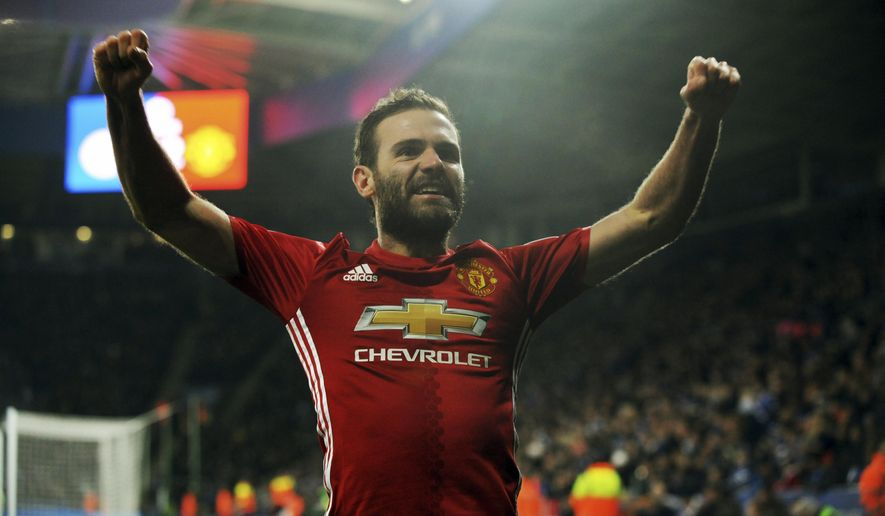 Manchester United's Juan Mata celebrates after scoring his side's third goal during the English Premier League soccer match between Leicester City and Manchester United at the King Power Stadium in Leicester, England, Sunday, Feb. 5, 2017. (AP Photo/Rui Vieira)