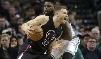 Los Angeles Clippers forward Blake Griffin (32) drives toward the basket past Boston Celtics forward Amir Johnson in the first half of an NBA basketball game, Sunday, Feb. 5, 2017, in Boston. (AP Photo/Steven Senne)