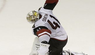 Arizona Coyotes goalie Mike Smith (41) celebrates after the Coyotes beat the San Jose Sharks in an NHL hockey game in San Jose, Calif., Saturday, Feb. 4, 2017. The Coyotes won in a shootout, 3-2. (AP Photo/Jeff Chiu)