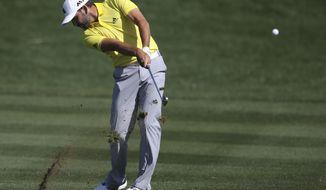 Sergio Garcia of Spain plays a shot on the 9th hole during the final round of the Dubai Desert Classic golf tournament in Dubai, United Arab Emirates, Sunday, Feb. 5, 2017. (AP Photo/Kamran Jebreili)