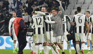 Juventus players celebrate their 1-0 win over Inter Milan at the end of a Serie A soccer match, at the Juventus Stadium in Turin, Italy, Sunday, Feb. 5, 2017. (Andrea Di Marco/ANSA via AP)