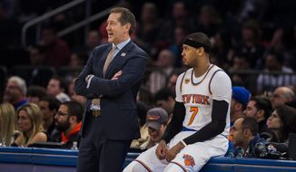 New York Knicks coach Jeff Hornacek, left, talks to Carmelo Anthony during the second half of the team's NBA basketball game against the Cleveland Cavaliers on Saturday, Feb. 4, 2017, in New York. (AP Photo/Andres Kudacki)