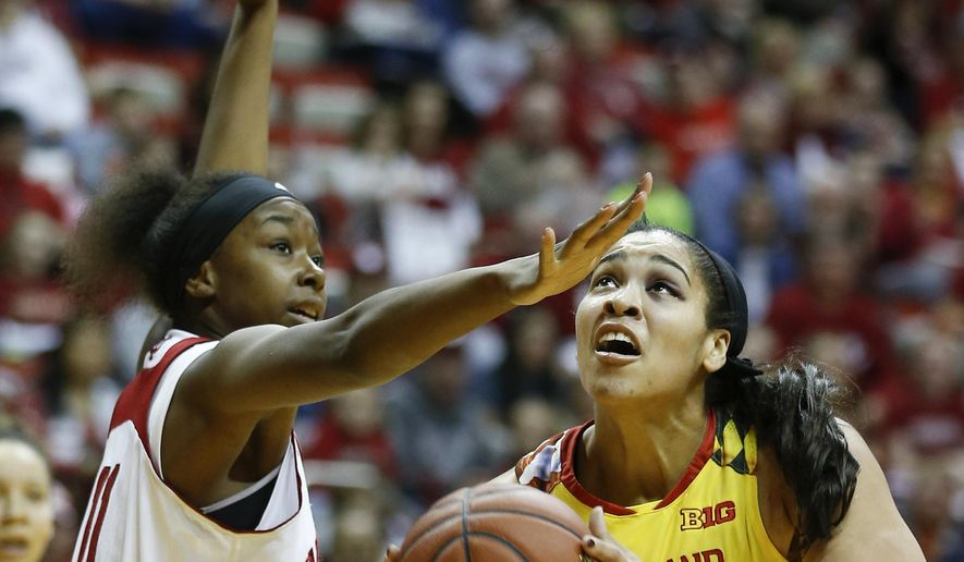 Maryland center Brionna Jones (42) gets past Indiana forward Kym Royster (11) during the first half of an NCAA college basketball game Sunday, Feb. 5, 2017, in Bloomington, Ind. (AP Photo/Sam Riche)