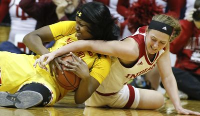 Maryland forward Brianna Fraser (34) keeps the ball from Indiana forward Amanda Cahill (33) during the first half of an NCAA college basketball game, Sunday, Feb. 5, 2017, in Bloomington, Ind. (AP Photo/Sam Riche)