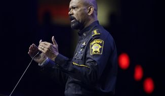 FILE - In this May 20, 2016, file photo, Milwaukee County Sheriff David Clarke speaks at the National Rifle Association convention in Louisville, Ky. With a brash, unapologetic personality reminiscent of President Donald Trump, Clarke is positioning himself as an in-your-face conservative firebrand who has some Republicans swooning over his prospects for higher office. (AP Photo/Mark Humphrey, File)