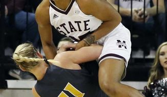 MississippI State forward Victoria Vivians, top, tries to pull the ball away from Missouri guard Lindsey Cunningham (11) during the first half of an NCAA college basketball game in Starkville, Miss., Sunday, Feb. 5, 2017. (AP Photo/Rogelio V. Solis)