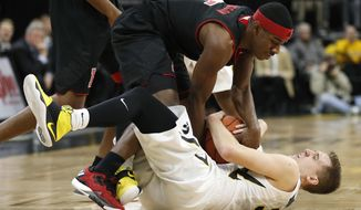Nebraska guard Glynn Watson Jr., top, tries to steal the ball from Iowa guard Jordan Bohannon, bottom, during the first half of an NCAA college basketball game, Sunday, Feb. 5, 2017, in Iowa City, Iowa. (AP Photo/Charlie Neibergall)