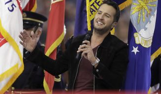 Country music singer Luke Bryan sings the National Anthem, before the NFL Super Bowl 51 football game between the New England Patriots and the Atlanta Falcons, Sunday, Feb. 5, 2017, in Houston. (AP Photo/Darron Cummings)