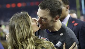 New England Patriots' Tom Brady kisses his wife Gisele Bundchen after defeating the Atlanta Falcons in overtime at the NFL Super Bowl 51 football game Sunday, Feb. 5, 2017, in Houston. The Patriots defeated the Falcons 34-28. (AP Photo/David J. Phillip)