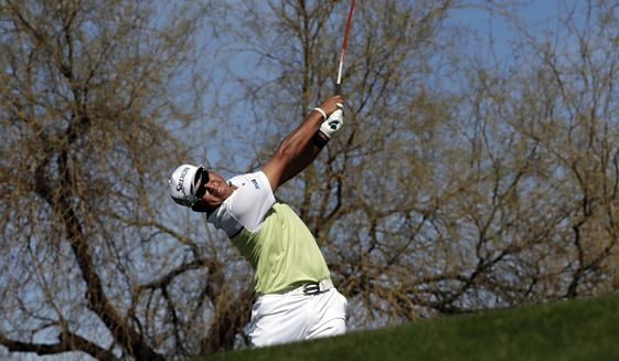 Hideki Matsuyama, of Japan, hits from the sixth tee during the final round of the Waste Management Phoenix Open golf tournament, Sunday, Feb. 5, 2017, in Scottsdale, Ariz. (AP Photo/Matt York)