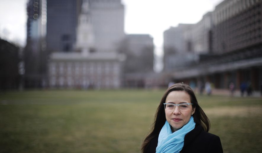 Rhea Powell poses for a photograph in view of Independence Hall in Philadelphia, Thursday, Feb. 2, 2017. The massive turnout for last month's women's marches protesting the policies of the Trump administration have led to calls for sustained political activism to help Democrats get back in power. (AP Photo/Matt Rourke)