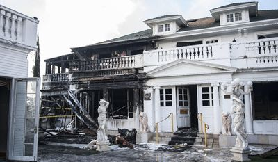 About 40 firefighters from Anaheim, Orange, Garden Grove and Fullerton responded to a fire at the Anaheim White House on Saturday, Feb. 4, 2017. (Nick Agro/Orange County Register via AP)