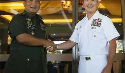 FILE - In this Nov. 22, 2016 file photo, U.S. Adm. Harry Harris, right, U.S. Commander of the U.S. Pacific Command, poses with Philippine Armed Forces Chief Gen. Ricardo Visaya for a photo following their annual Mutual Defense Board meeting at Camp Aguinaldo in suburban Quezon city, northeast of Manila, Philippines. Harris will be the highest-ranking American officer to attend the Cobra Gold military exercises in Thailand since a coup there three years ago. The U.S. had scaled down the 10-day drills since the 2014 coup, and Harris' scheduled appearance at the Feb. 14 opening ceremony is seen as a sign that the U.S.-Thai military ties are on the mend. (AP Photo/Bullit Marquez, File)