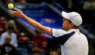 United States' Sam Querrey throws up ball to serve to Switzerland's Adrien Bossel during a Davis Cup tennis match, Sunday, Feb. 5, 2017, in Birmingham, Ala. (AP Photo/Butch Dill)