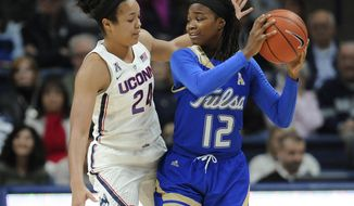 Tulsa's Shug Dickson, right, keeps the ball from Connecticut's Napheesa Collier, left, in the half of an NCAA college basketball game, Sunday, Feb. 5, 2017, in Storrs, Conn. (AP Photo/Jessica Hill)