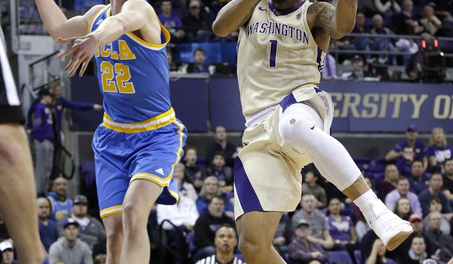 Washington's David Crisp (1) drives to the basket ahead of UCLA's TJ Leaf (22) during the first half of an NCAA college basketball game Saturday, Feb. 4, 2017, in Seattle. (AP Photo/Elaine Thompson)