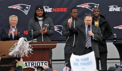 New England Patriots coach Bill Belichick acknowledges the fans who turned out at Gillette Stadium in Foxboro, Massachusetts on Monday. (Associated Press)