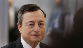 FILE - In this Jan. 19, 2017 file picture President of the European Central Bank, Mario Draghi , is on his way to a news conference after a meeting of the governing council in Frankfurt, Germany.   The head of the European Central Bank says  Monday Feb. 6, 2017 that its monetary stimulus efforts are still very much needed to support the continent's economic recovery  despite the recent spike in inflation in the countries that use the euro currency. (AP Photo/Michael Probst,file)