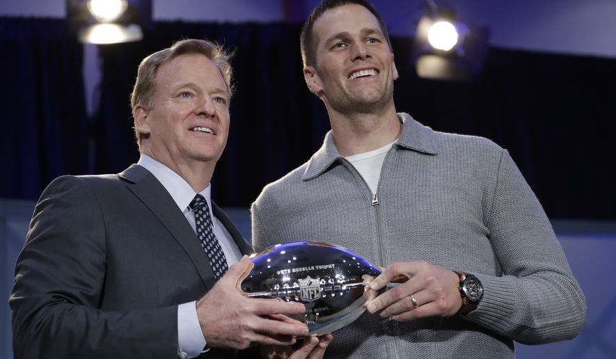 NFL Commissioner Roger Goodell and New England Patriots quarterback Tom Brady pose with the MVP trophy during a news conference after the NFL Super Bowl 51 football game Monday, Feb. 6, 2017, in Houston. Brady was named the MVP of Super Bowl 51. (AP Photo/David J. Phillip)