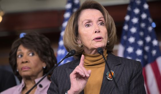 House Minority Leader Nancy Pelosi of Calif., joined by Rep. Maxine Waters, D-Calif., criticizes President Donald Trump's pro-Wall Street policies during a news conference on Capitol Hill in Washington, Monday, Feb. 6, 2017. (AP Photo/J. Scott Applewhite) ** FILE **